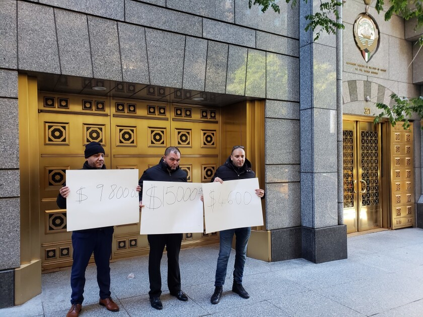 From left, limo drivers Adil Benelkour, 44; Yousef Zaki, 36; Mohammed Belhadi, 36 protest outside the Permanent Mission of the State of Kuwait to the United Nations. They say they haven't paid yet for driving around the delegation during this years UN General Assembly.