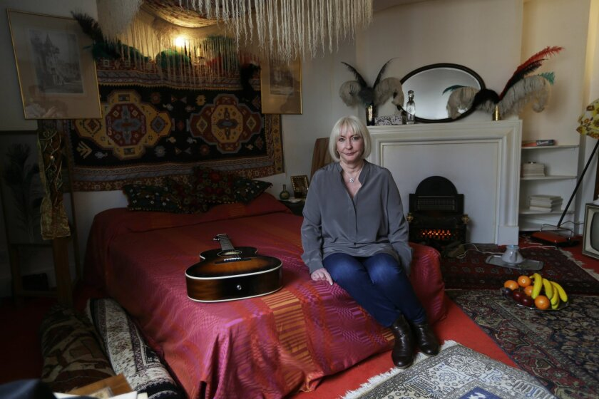 Kathy Etchingham, the former girlfriend of U.S. musician Jimi Hendrix, poses for photographers during a media preview in the bedroom of his former central London flat, at 23 Brook Street, London, Monday, Feb. 8, 2016. The flat where Hendrix lived in 1968 and 1969 opens to the public as a permanent