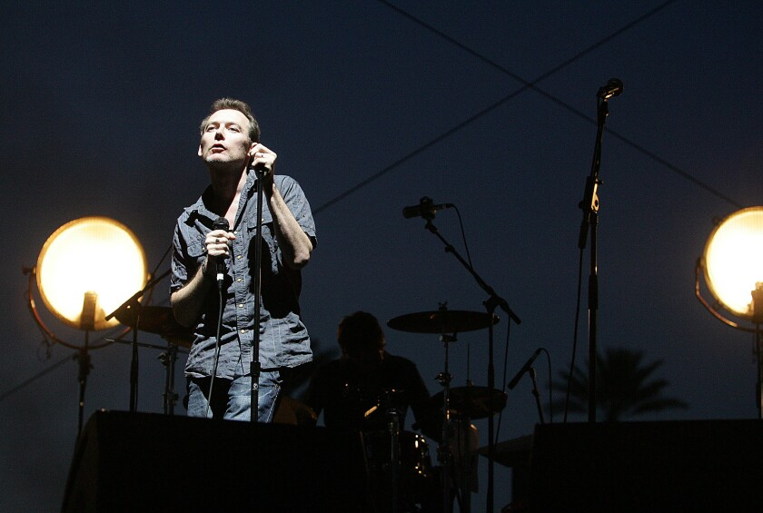 """Jim Reid, lead singer of Jesus and Mary Chain, performs at Coachella in 2007. The band has announced shows celebrating the 30th anniversary of its debut album, """"Psychocandy."""""""