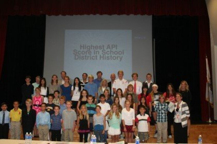 (Above) RSF School board members with students honored Oct. 11 for achieving perfect scores on their STAR tests. Photo/Karen Billing