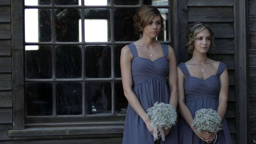 Bridesmaids pose for wedding photographs in Stevinson, Calif., in 2013.
