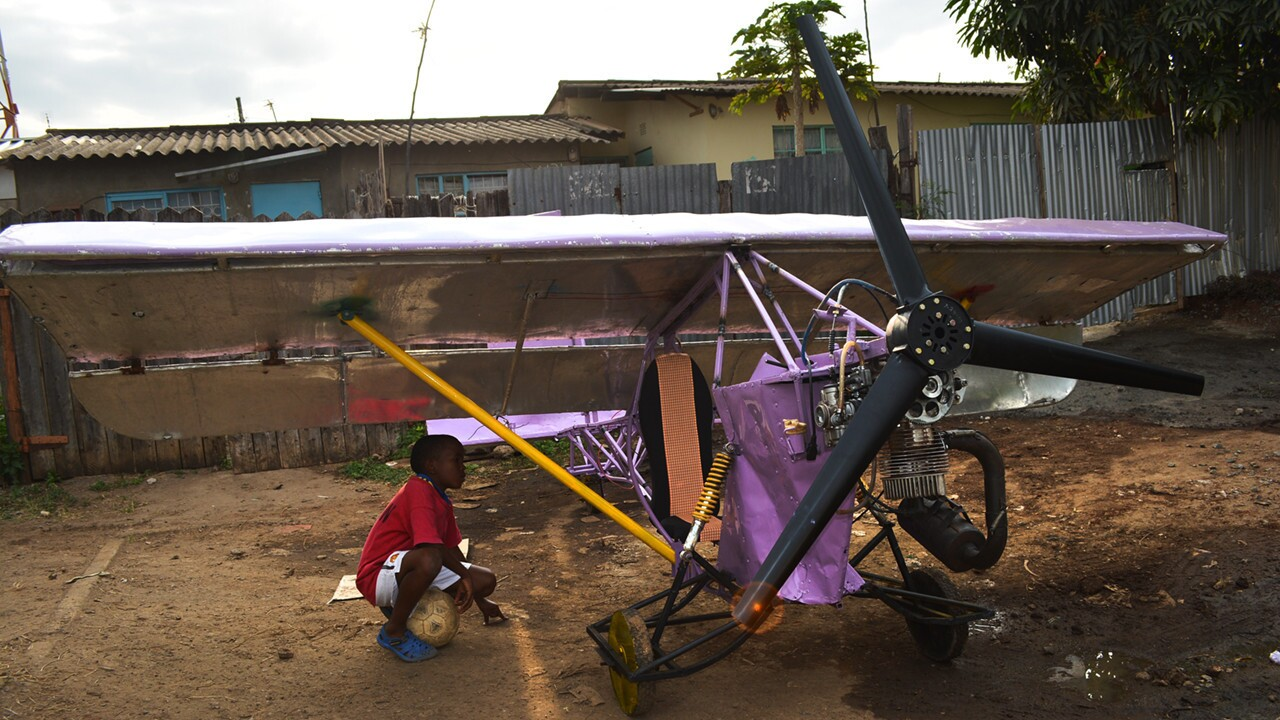 Eight years after Gabriel Nderitu started work on Project One, his first attempt to build a plane, Project 14 stands like a creation from a child's Meccano set: painted purple, with yellow wooden wheels and a red wooden control panel and the kind of plastic switches used to turn on lights in houses.
