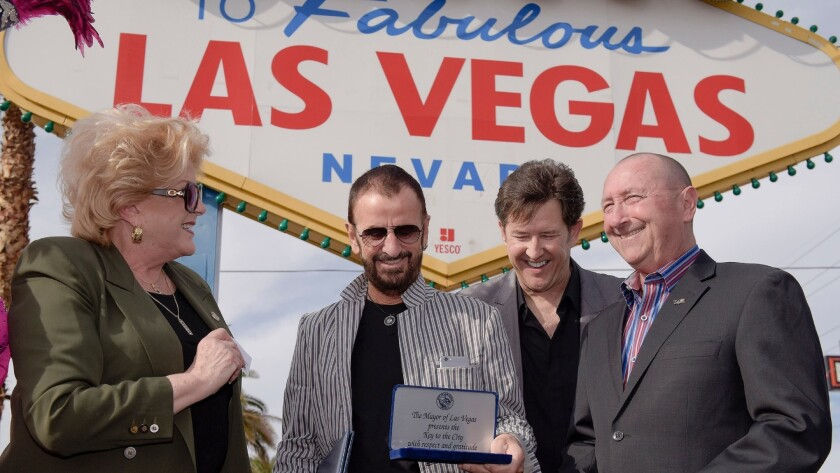 Ringo Starr, second from left, is awarded the Key to the City of Las Vegas by Mayor Carolyn G. Goodm