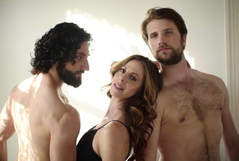 "Kirsten Bloom Allen, center, appears with Tigran Sargsyan, left, and Magnus Christoffersen in the video ""A Reason to Fight"" featuring music by the rock band Disturbed and produced by Allen's Arc Entertainment Company."