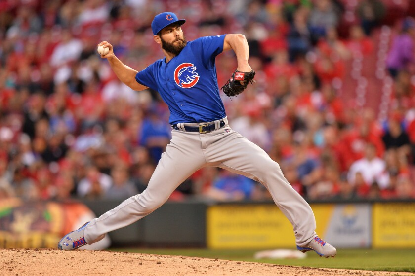 Chicago Cubs starter Jake Arrieta delivers a pitch against the Cincinnati Reds on April 21.