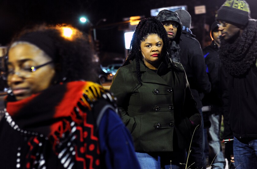 Activist Johnetta Elzie, 25, stands outside the Ferguson, Mo., police station during a demonstration.