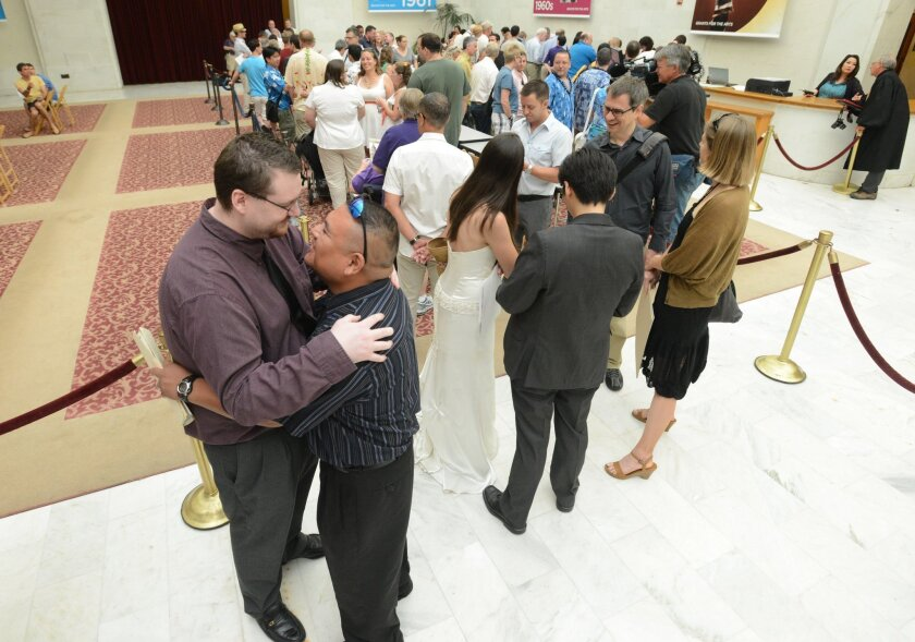 Couples wait in line to get married at San Francisco City Hall.