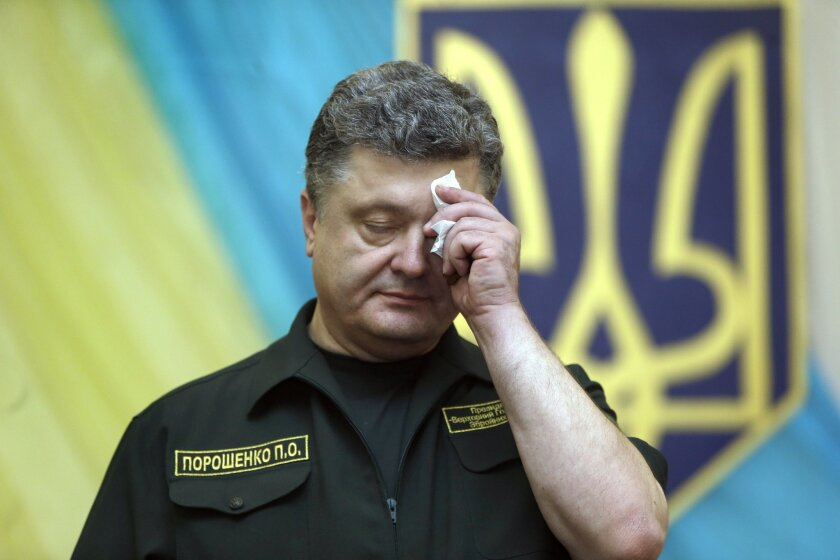 Ukrainian President Petro Poroshenko attends a news conference in the southern coastal town of Mariupol, Ukraine, Monday, Sept. 8, 2014. Poroshenko made a surprise trip Monday to a key city in southeastern Ukraine as a cease-fire between Russian-backed rebels and Ukrainian troops appeared to be largely holding. (AP Photo/Sergei Grits)
