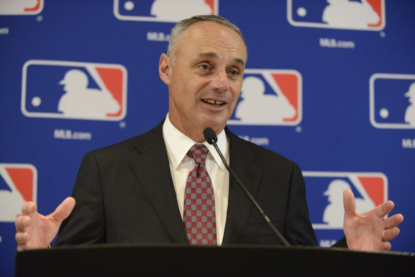 FILE - In this Aug. 13, 2015, file photo, Major League Baseball Commissioner Rob Manfred speaks to members of the media after the owners meetings in Chicago. Manfred expects to have a decision within a few days on two of the first three cases covered by the sport's new domestic violence policy. (AP