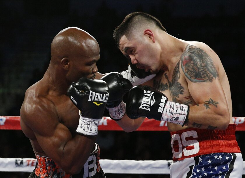 Timothy Bradley, left, hits Brandon Rios during a WBO welterweight title bout Saturday, Nov. 7, 2015, in Las Vegas. (AP Photo/John Locher)