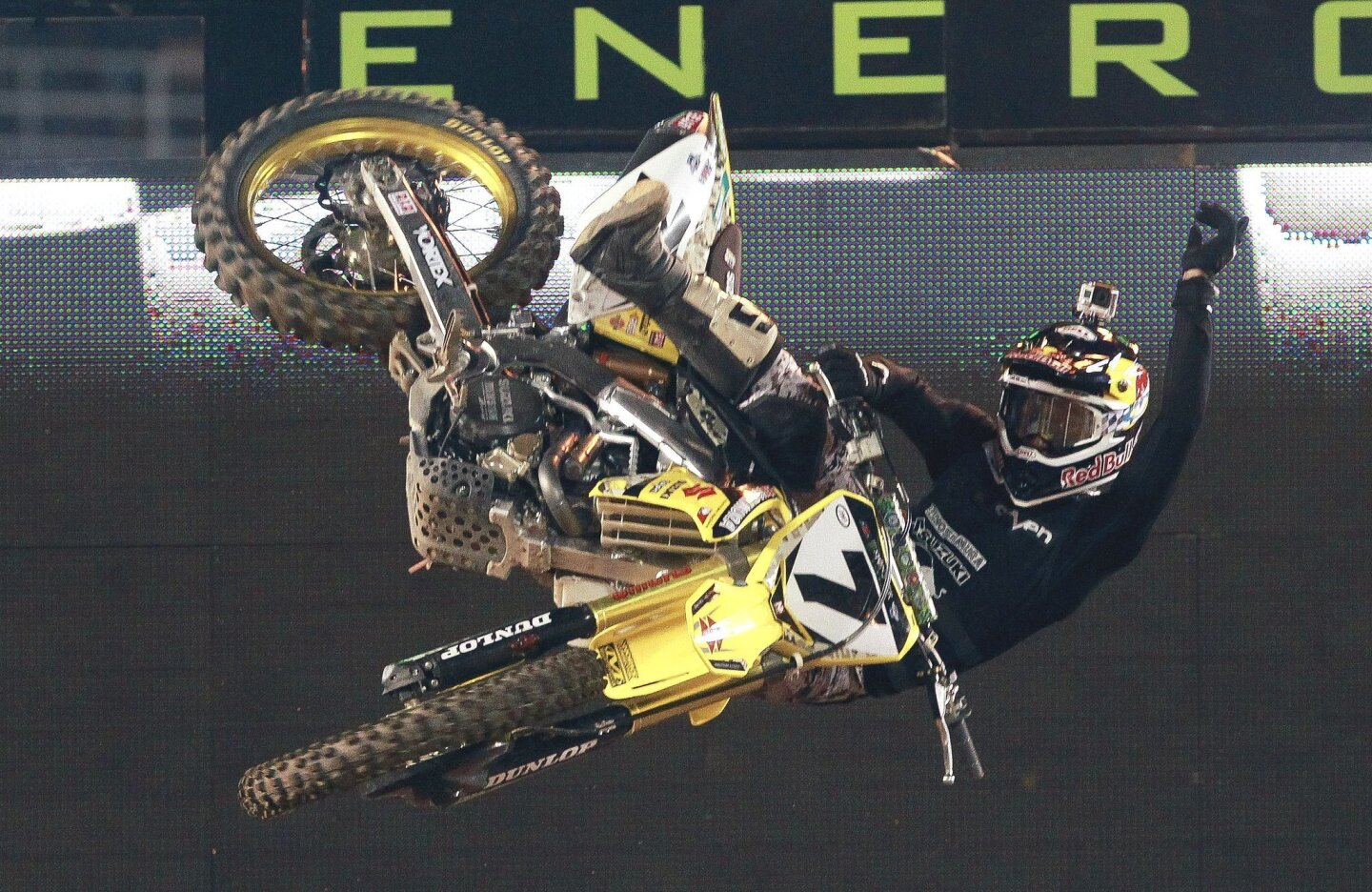 James Stewart celebrates as he crosses the finish line to win the Main Event of the Monster Energy Supercross at Qualcomm Stadium on Saturday, February 8, 2014.