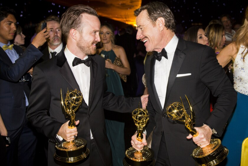 """Breaking Bad"" stars Aaron Paul, left, with his Emmy for best supporting actor in a drama series, and Bryan Cranston, with Emmys for best actor and producer in a drama series, at the post-ceremony Governors' Ball in the L.A. Convention Center."