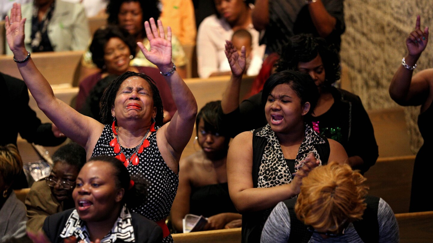 """Church members sing and pray at the Southern Baptist Church with pastor Dr. Donte L. Hickman Sr., (not pictured) two days after Baltimore authorities released a report on the death of Freddie Gray on May 3, 2015 in Baltimore. Maryland Gov., Larry Hogan called for a statewide """"Day of Prayer and Peace"""" on Sunday."""