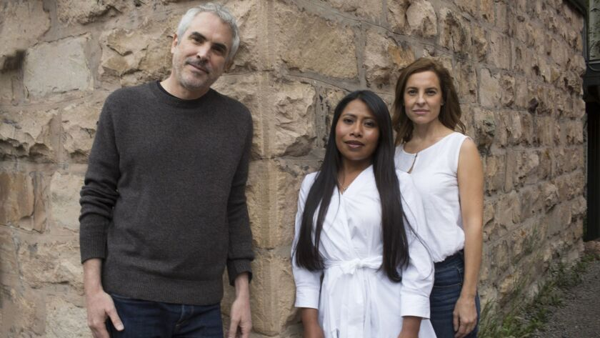 """Roma"" writer and director Alfonso Cuaron with actresses Yalitza Aparicio and Marina de Tavira, phot"