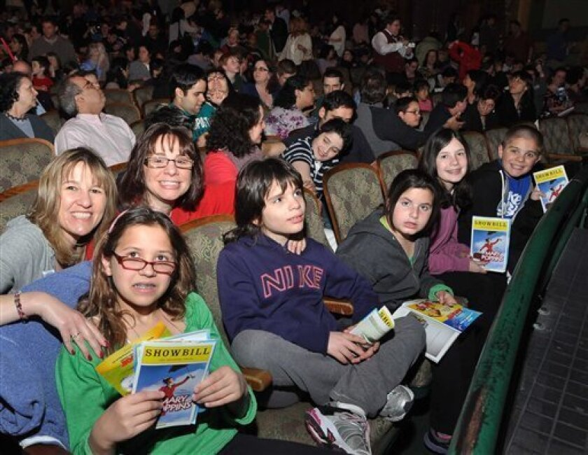 "Families attend an autism-friendly performance of the musical ""Mary Poppins"" on Broadway in 2012."