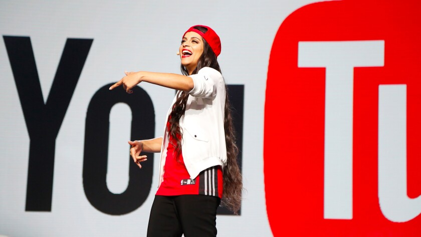 """Lilly Singh, who performs in comedy sketch videos on her own YouTube channel, talks to advertisers Thursday at the Google/YouTube """"Brandcast"""" in New York."""