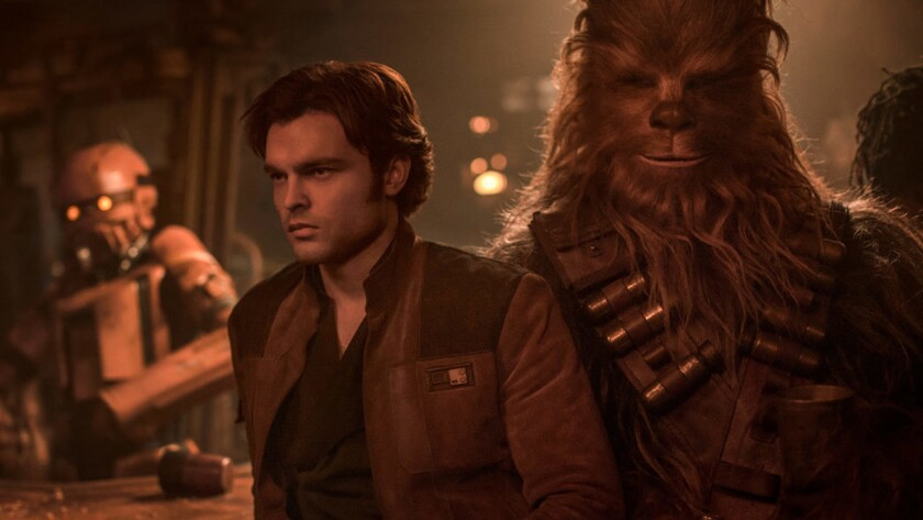 "Alden Ehrenreich as Han Solo, with Chewbacca (Joonas Suotamo), in ""Solo: A Star Wars Story.""(Luc"