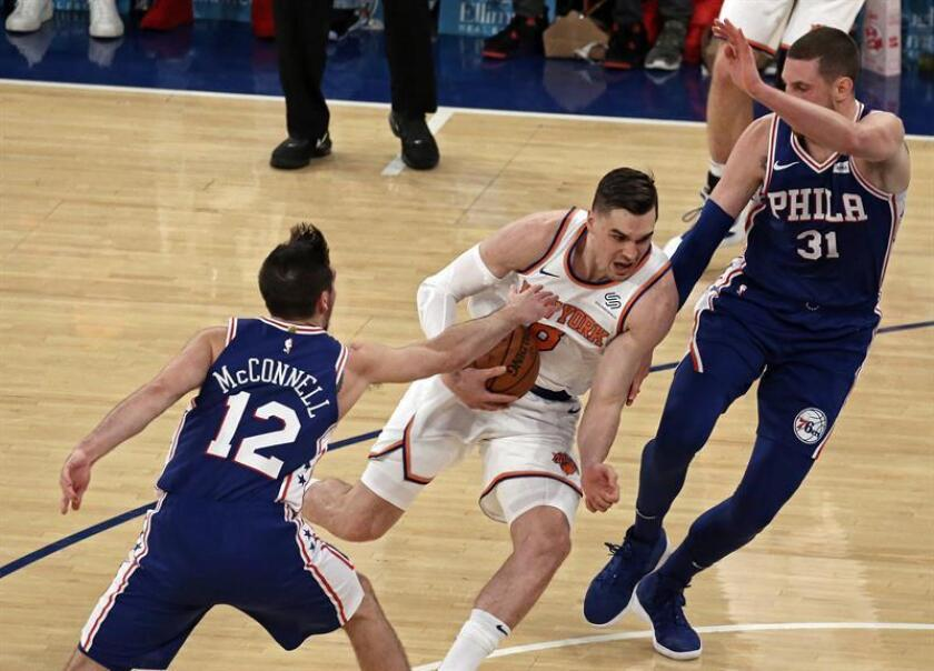 New York Knicks forward Mario Hezonja (C) is double teamed by Philadelphia 76ers defenders in the second half of their NBA basketball game between the Philadelphia 76ers and the New York Knicks at Madison Square Garden in New York, USA, Jan.13, 2019 EPA-EFE/PETER FOLEY SHUTTERSTOCK OUT