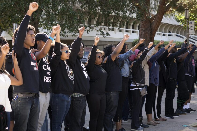 University of California, Irvine students raise their fists in solidarity with the University of Missouri demonstrations, in Irvine on November 12.