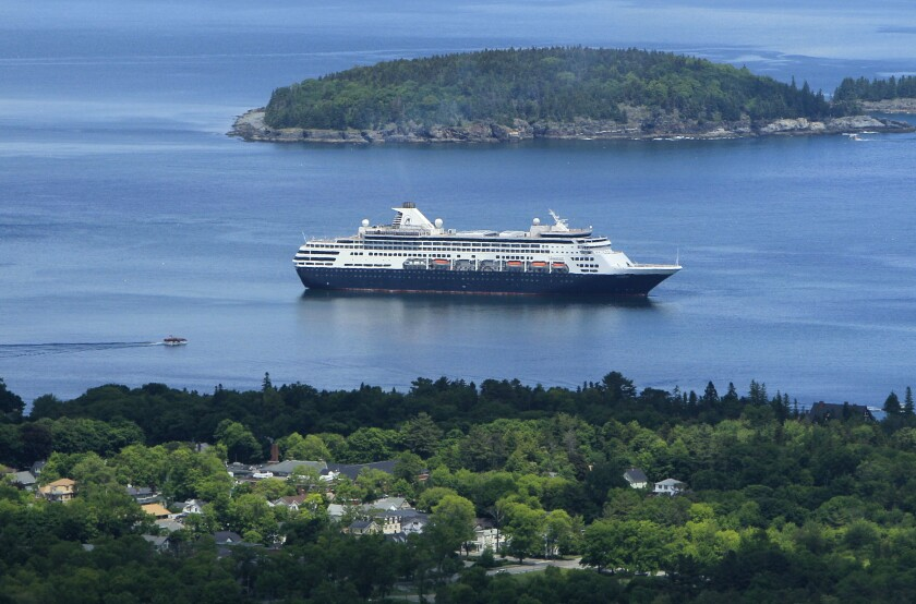 This 2010 file photo shows a cruise ship in Maine. Below, a San Diego doctor shares his story of boarding a cruise as the coronavirus pandemic broke out.
