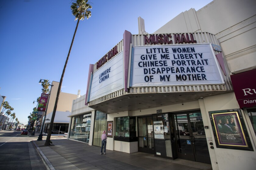 "The new marquee of the Lumiere Cinema at the Music Hall with the titles ""Little Women,"" ""Give Me Liberty,"" ""Chinese Portrait"" and ""Disappearance of My Mother."""