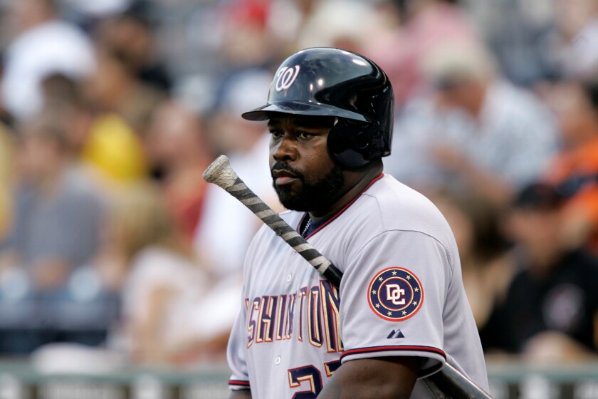 Washington Nationals' Dmitri Young warms up on deck against the Pittsburgh Pirates.