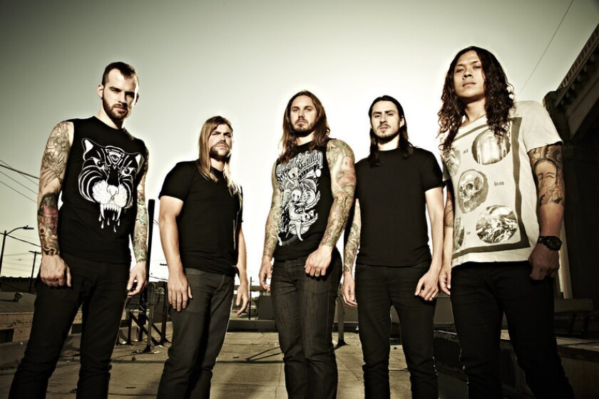 """Tim Lambesis, center, with his band """"As I Lay Dying."""" Credit:asilaydying.com"""
