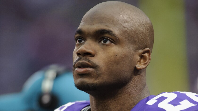The Vikings' Adrian Peterson looks on during the game against the Carolina Panthers in Minneapolis on Oct. 13, 2013.