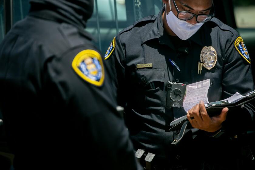 San Diego Police officers make a traffic stop along El Cajon Boulevard on June 23, 2020, in San Diego.