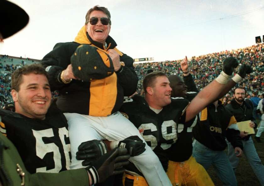 In this Nov. 20, 1993, file photo, Iowa football coach Hayden Fry is carried off the field after his team defeated Minnesota, giving him his 200th career victory in Iowa City, Iowa.