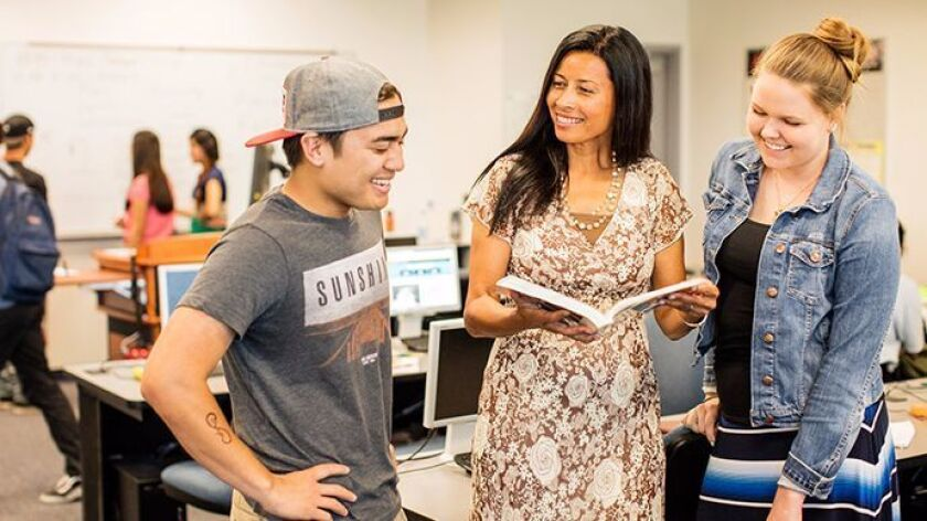 Carmen Carrasquillo Jay (center) co-coordinates the San Diego Community College District's Honors Program, which is credited with boosting the district's success with diverse transfer students and will play a key role in the new collaborative with UC San Diego.
