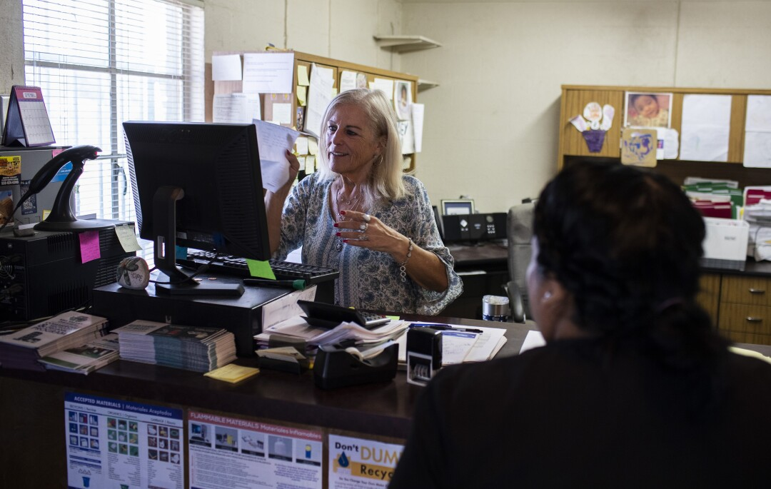 Public Utility District office manager Patty Silva processes a customer's bill.