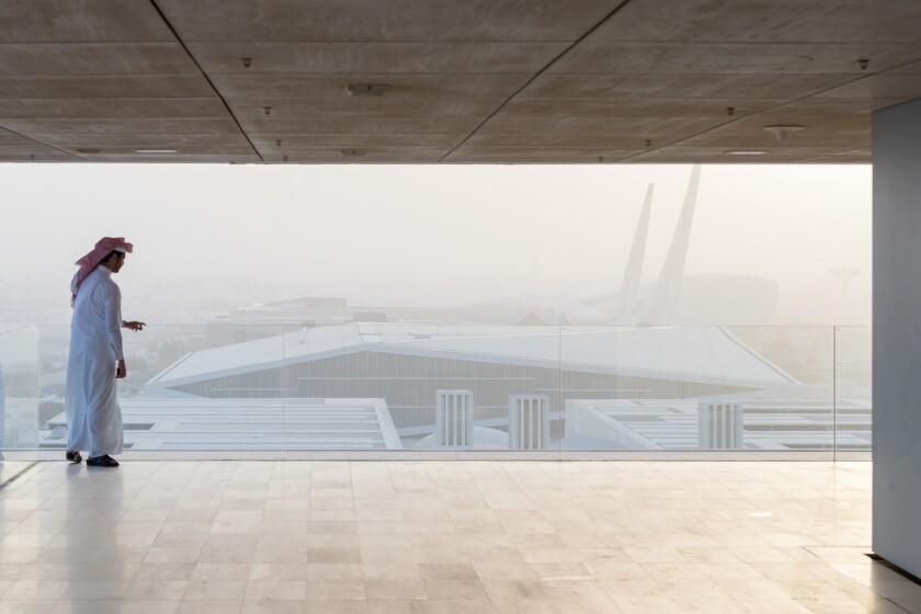 The Qatar National Library by Dutch architecture firm OMA. These photographs are made by Iwan Baan.
