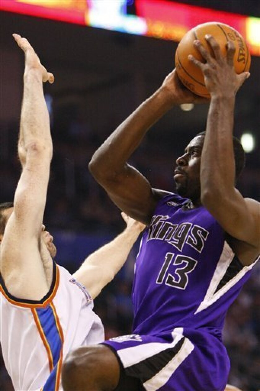 Sacramento Kings Tyreke Evans (13) goes up for a basket as Oklahoma City Thunder's Nick Collison defends in the first quarter of an NBA basketball game in Oklahoma City, Tuesday, March 2, 2010. (AP Photo/Alonzo Adams)