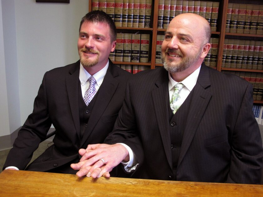 Longtime Cincinnati couple Karl Rece Jr., left, and Gary Goodman speak to media at a law firm in Cincinnati, Wednesday, April 30, 2014. They are among 12 plaintiffs named in a Wednesday lawsuit seeking to strike down Ohio's gay marriage ban and allow same-sex couples to marry in the state. (AP Photo/Amanda Lee Myers)