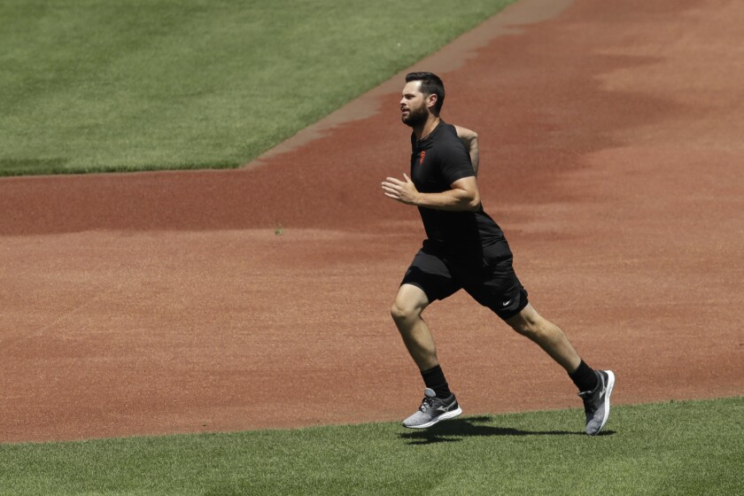 San Francisco Giants' Brandon Belt runs during a baseball practice on Friday, July 3, 2020, in San Francisco. (AP Photo/Ben Margot)