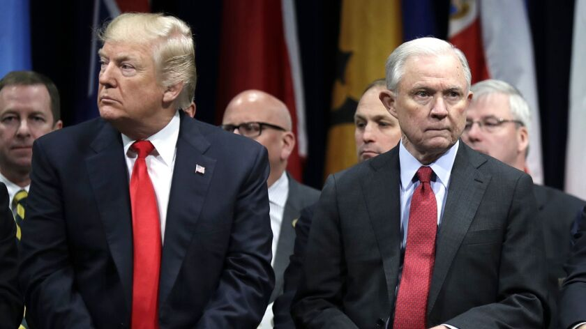President Donald Trump and Attorney General Jeff Sessions attend the FBI National Academy graduation ceremony in Quantico, Va. on Dec. 15, 2017.