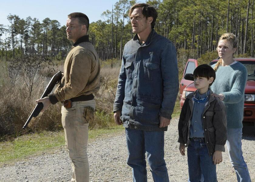 "From left, Joel Edgerton, Michael Shannon, Jaeden Lieberher and Kirsten Dunst in director Jeff Nichols' sci-fi thriller ""Midnight Special."" It is scheduled as part of this year's South by Southwest Film Festival."