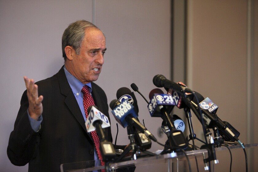 Lanny Davis speaks during a press conference in Philadelphia in 2015 while representing Pennsylvania Attorney General Kathleen Kane.