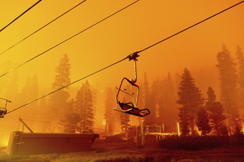 The Caldor fire burns as a chair lift sits at the Sierra-at-Tahoe ski resort