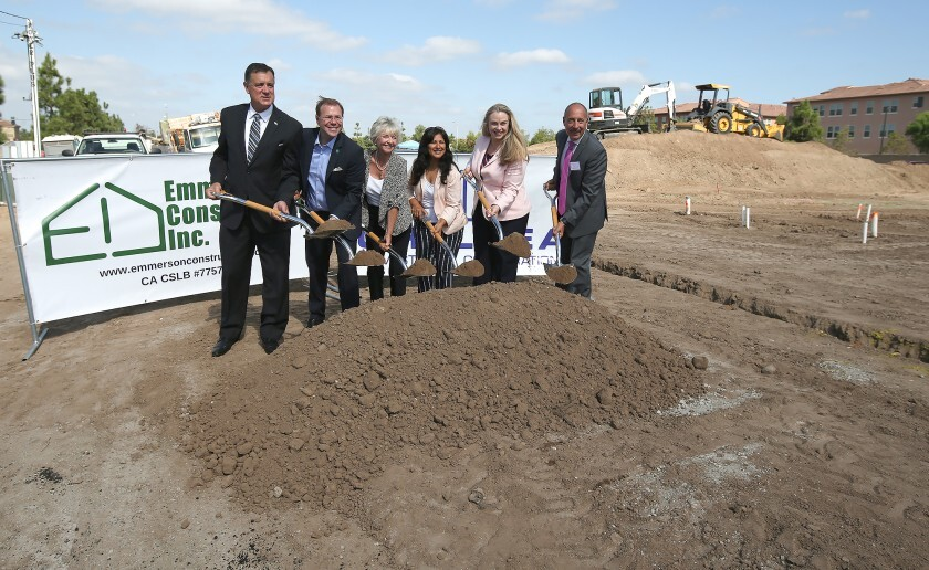 County and Irvine officials gather for a ceremonial ground-breaking for an affordable housing development.