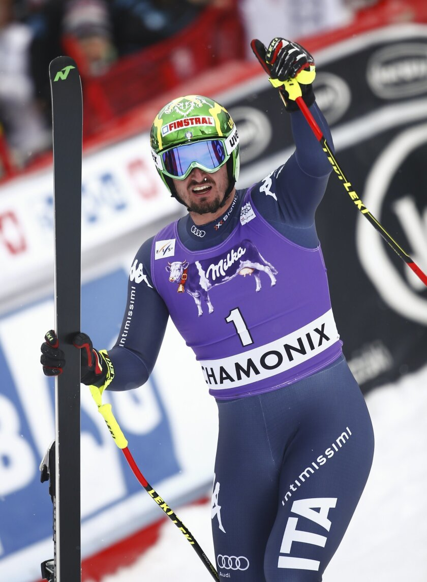 Italy's Dominik Paris celebrates his second place after completing the downhill portion of an alpine ski, men's World Cup combined race, in Chamonix, France, Friday, Feb. 19, 2016. (AP Photo/Giovanni Auletta)