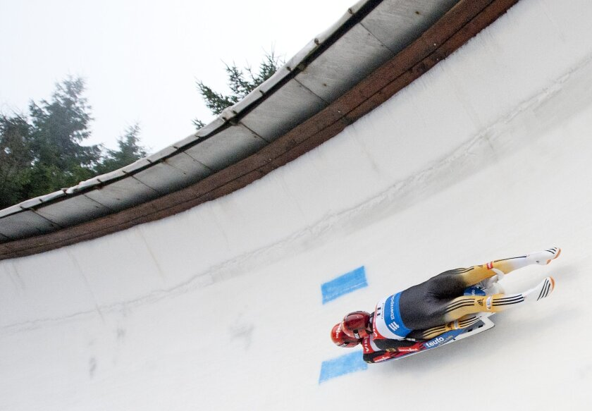 Winners Toni Eggert, front, and Sascha Benecken of Germany speed during the doubles at the luge World Cup in Oberhof, Germany, Saturday, Jan. 11, 2014. (AP Photo/Jens Meyer)