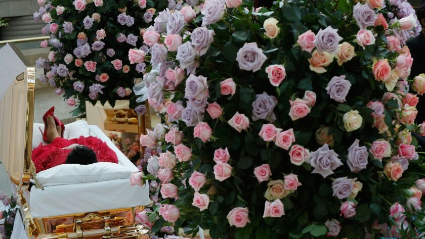 The body of Aretha Franklin lies in repose at Detroit's Charles H. Wright Museum of African American History on Tuesday.