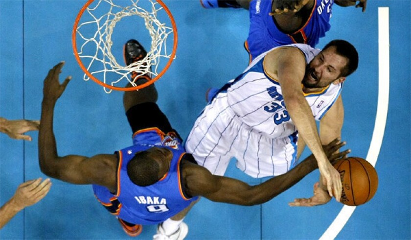 New Orleans' Ryan Anderson, right, has his shot bocked by Serge Ibaka in a game against Oklahoma City on Friday.