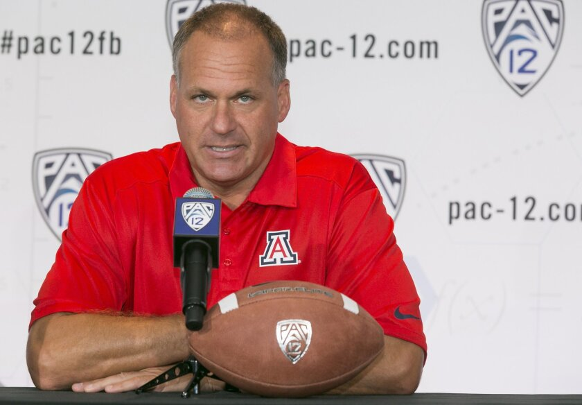 FILE-This July 23, 2014 file photo shows Arizona head coach Rich Rodriguez takes questions at the 2014 Pac-12 NCAA college football media days in Los Angeles. Rodriguez is among many football minds who believe the Pac-12 has never been better. The West Coast's top conference is stacked with elite quarterbacks and top-level coaching talent yet again this fall, and it might even be primed to crown a powerful champion with a chance to break the South's grip on the national title in the playoff. (AP Photo,File)