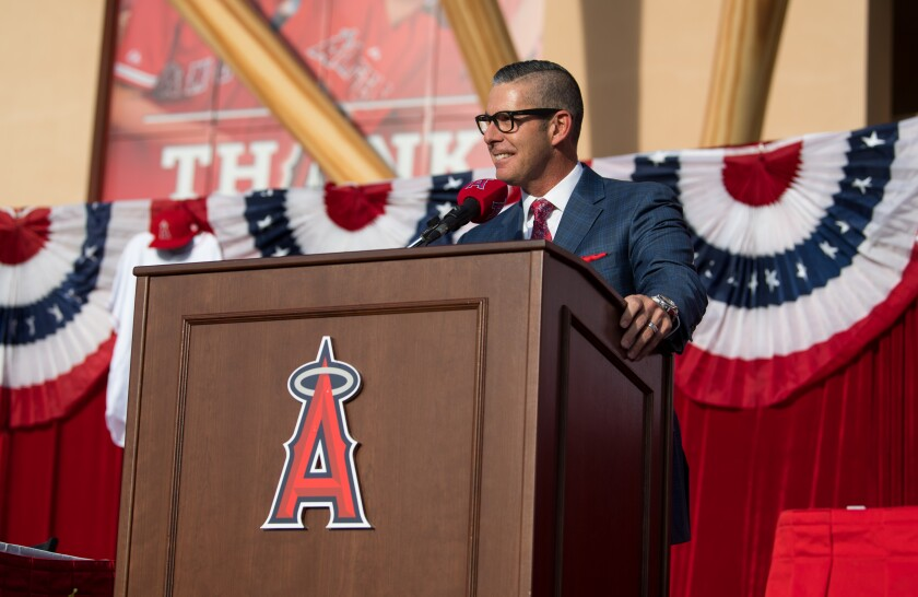 Angels broadcaster Victor Rojas speaks during a news conference.