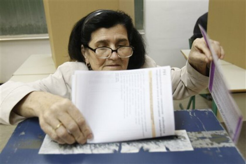 A Bosnian woman casts her ballot at a poling station in Sarajevo, Bosnia and Herzegovina, on Sunday, Oct. 3, 2010. Bosnians head to the polls Sunday for a general election likely to further entrench the country's ethnic divisions, threatening closer ties to the West and possible EU entry.(AP Photo/Amel Emric)