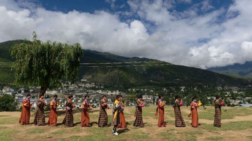 In this 2013 photo, Bhutanese teenagers practice before a cultural event to celebrate the birth of B