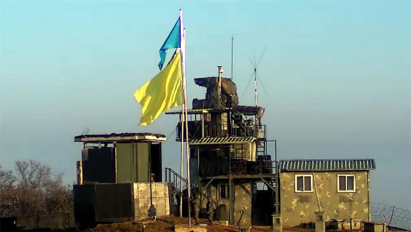 A yellow flag is raised at a guard post of South Korea in the demilitarized zone.